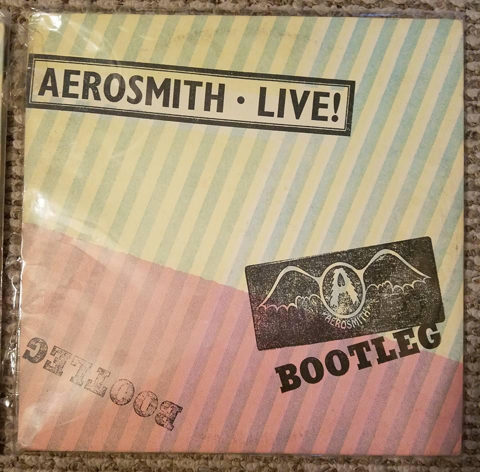 Aerosmith live bootleg album cover something is