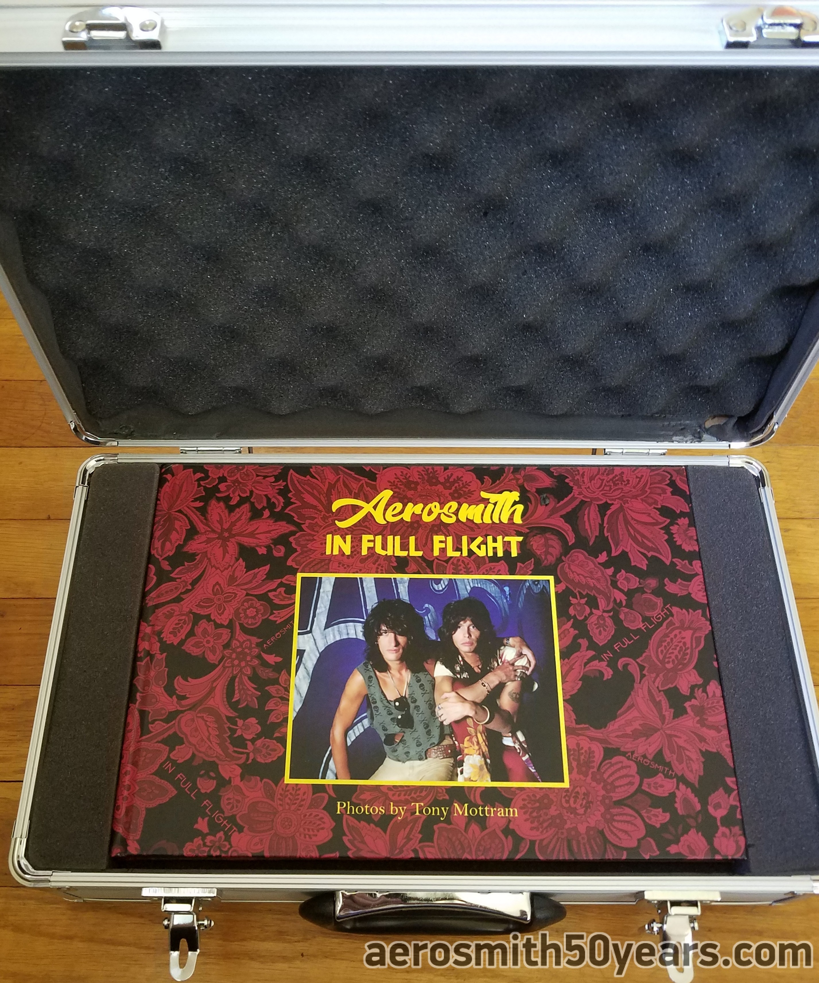 """Aerosmith  """"In Full Flight"""" Photograph Book By Tony Mottram. Released In 2017 The Book Consists Of Photos Captured During The 1980's & 90's. It Is A Limited Edition Of 300 Copies. Which You Could Purchase With Or Without Flight Case."""
