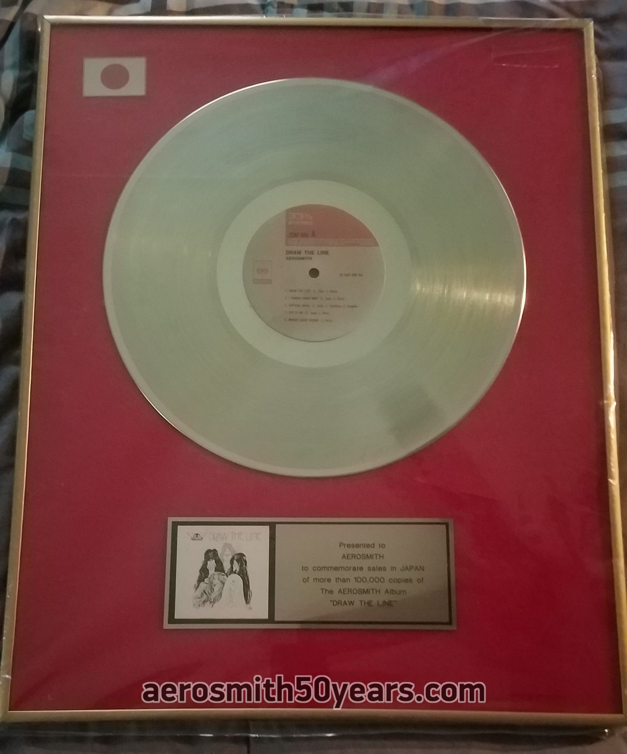 Draw The Line – Japan Record Award Presented To Aerosmith. This award came from the collection of former manager Tim Collins.